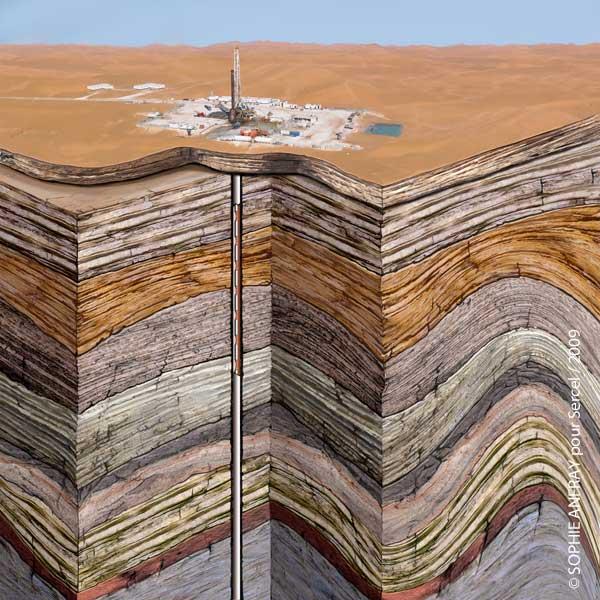 Vue d'ensemble d'une plateforme de forage avec croûte terrestre en coupe.
