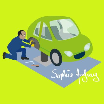 Garagiste qui change une roue de voiture